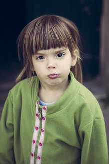 Portrait of little girl pouting mouth - LVF001109
