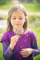 Portrait of little girl with cake pop - SARF000530
