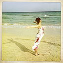 Pregnant woman standing on the Beach, Fuerteventura, Spain - DRF000667