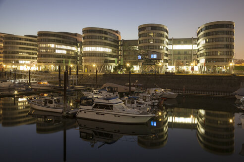 Germany, North Rhine-Westphalia, Duisburg, Inner harbour and office buildings, Five Boats, by night - WIF000608