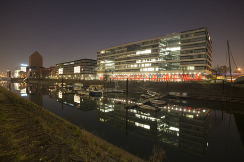 Germany, North Rhine-Westphalia, Duisburg, Hitachi Power Office and Marina by night - WIF000610