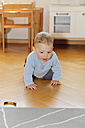 Baby boy at home crawling on the floor - LAF000786