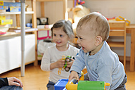 Brother and sister playing at home - LAF000795
