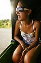 Vietnam, female tourist driving in tuk tuk taxi - MBEF001034