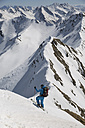 Austria, East Tyrol, Defereggental, Man backcountry skiing - FF001409