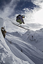 Austria, East Tyrol, Defereggental, Man backcountry skiing - FF001407