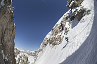 Italy, Dolomites, Val Gardena, Man backcountry skiing - FF001416