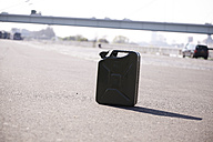Petrol can on tarmac - FMKF001163