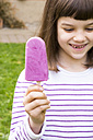Portrait of little girl with yoghurt blueberry ice lolly - LVF001124