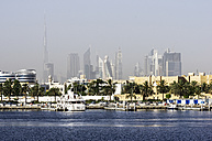 UAE, Dubai,  Port Saeed with Downtown skyline in background - THAF000296
