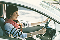 Spain, Barcelona, Young woman in car - EBSF000240