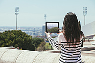 Spain, Barcelona, Young woman golding digital tablet - EBSF000235