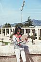 Spain, Barcelona, Young woman using digital tablet - EBSF000238