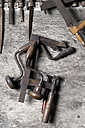 Germany, Bavaria, Josefsthal, wood drill, sew, bar clamp and files at historic blacksmith's shop - TCF003950