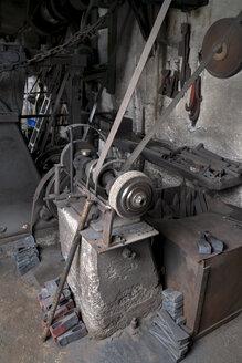 Germany, Bavaria, Josefsthal, grinder at historic blacksmith's shop - TCF003956
