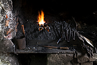 Germany, Bavaria, Josefsthal, forge with fire at historic blacksmith's shop - TCF003977