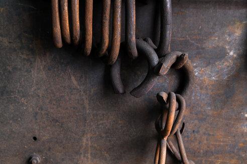 Germany, Bavaria, Josefsthal, rusty rings at historic blacksmith's shop - TCF003980
