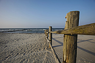 Germany, Mecklenburg-Western Pomerania, Baltic Sea, Wooden fence at beach - JTF000515