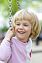 Portrait of smiling little girl on swing - JFEF000344