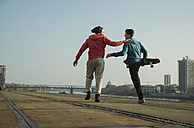 Young man and teenager with skateboard - UUF000448