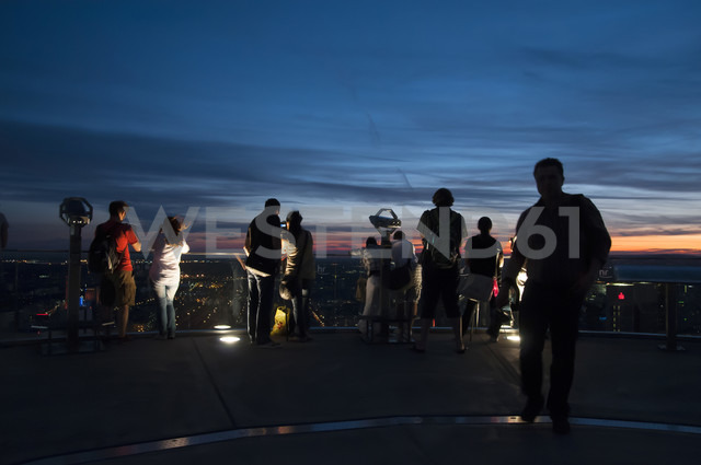 Germany, Hesse, Frankfurt, People on observation platform at blue hour - CST000297