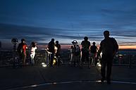Germany, Hesse, Frankfurt, People on observation platform at blue hour - CST000297