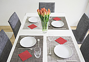 Laid table for four persons with flower vase of tulips - FLF000429
