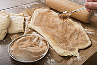 Sprinkling yeast dough with sugar and cinnamon powder - CSTF000303