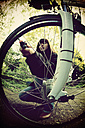 Woman inflating bicycle tire - HOH000756