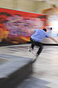 Skate boarder making Wallie at skateboard ground - LAF000744
