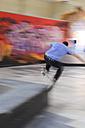 Skate boarder making Wallie at skateboard ground - LAF000744