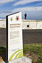 Portugal, Azores,Sao Miguel, Man standing on wall at Miradouro Escalvado - ON000465