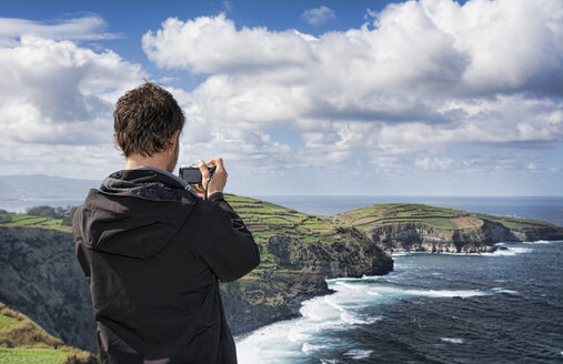 Portugal, Azores,Sao Miguel, Tourist capturing view - ONF000483