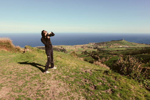 Portugal, Azores,Sao Miguel, Tourist capturing view - ONF000478