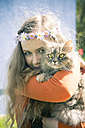 Portrait of female teenager with cat on her arms - SARF000568