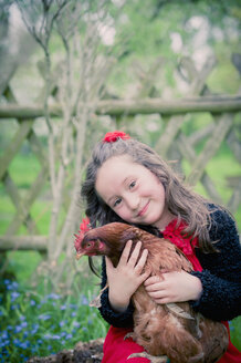 Portrait of little girl with chicken - MJF001102