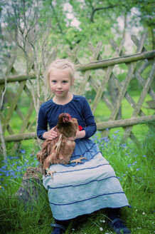 Portrait of little girl with chicken - MJF001103