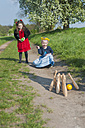 Two little girls bowling on the way - MJF001120
