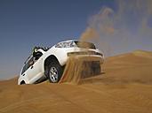 United Arab Emirates, Abu Dhabi, Jeep in desert, getting stuck - TM000010