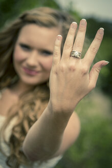Young woman showing hand with ring - ABAF001329