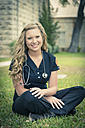 Portrait of smiling young female nurse - ABAF001332