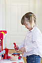 Little girl playing with children's kitchen - LVF001180