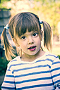 Portrait of asking little girl with plaits - LVF001189