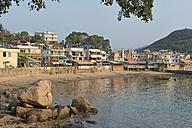 China, Hong Kong, Lamma Island, waterfront with houses and boat in Yung Shue Wan bay - SHF001241