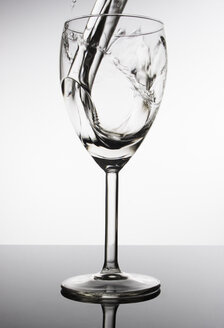 Water pouring into wine glass - CNF000032