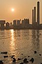China, Hong Kong, Lamma Island, sunset over a coal-fired power plant in Yung Shue Wan bay - SHF001243