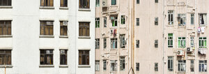 China, Hong Kong, Mid Levels, desolate front of a high rise with windows, laundry, downpipes and air-conditioning systems - SHF001246