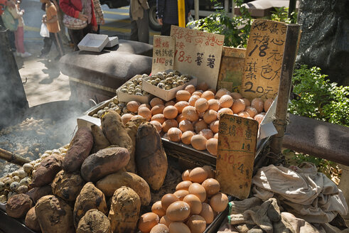 China, Hong Kong, stall of a street merchant with eggs and potatoes in downtown Kowloon - SH001251