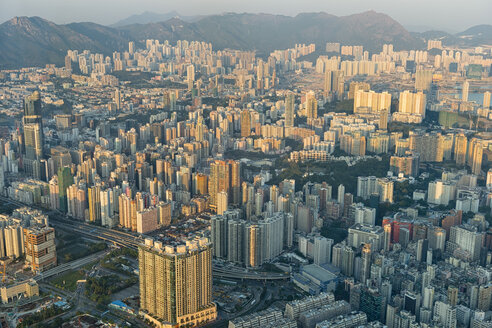 China, Hong Kong, Kowloon, view from the ICC tower on Kowloon city with skyscrapers in the evening sun - SHF001254
