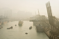 China, Hong Kong, container harbour with cranes and ships in morning mist - SHF001267